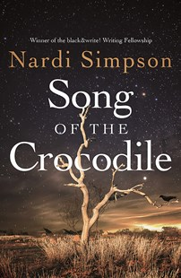 Image of the cover of the book Song of the Crocodile by author Nardi Simpson to accompany the book review by The Reading Edit on the same page. Cover image features the bare branches of a lone tree against a starry night sky. There is a black crow on one of the branches.
