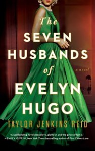 The cover of the book The Seven Husbands of Evelyn Hugo by author Taylor Jenkins Reid to accompany the book review by The Reading Edit on the same page. Cover image features a blonde woman wearing a green gown with a pearl necklace set against a rich red background.