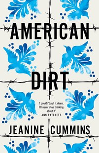 Image of the cover of the book American Dirt by Jeanine Cummins to accompany the book review by The Reading Edit on the same page. Cover image features a repeated pattern of blue birds and barbed wire against a white background.